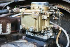 Old carburetor on an car engine Stock Image