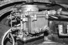 Old carburetor on an car engine. Old carburetor on an Vintage car engine. Black and white photo Royalty Free Stock Photo