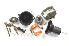 Old carburetor of motorcycle part disassembly. Old carburetor of motorcycle part disassembly isolate on white background Royalty Free Stock Image