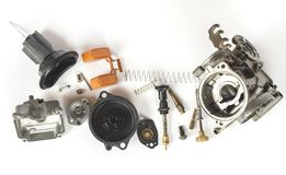 Old carburetor of motorcycle part disassembly. Royalty Free Stock Photography