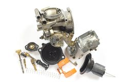 Old carburetor of motorcycle part disassembly. Old carburetor of motorcycle part disassembly isolate on white background Stock Photos