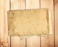 Old card on wooden planks Royalty Free Stock Images