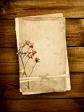 Old card on wooden planks Stock Photo