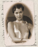 Old card with the young woman image Stock Photo