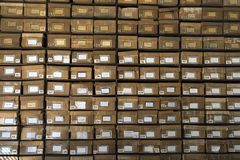 Old cardboard boxes fill shelves Stock Image