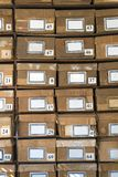 Old cardboard boxes fill shelves Stock Photo