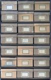 Old cardboard boxes fill shelves Royalty Free Stock Photos