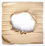 Old cardboard paper with a big hole Royalty Free Stock Photography