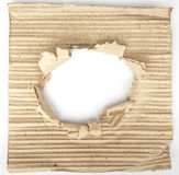 Old cardboard paper with a big hole Royalty Free Stock Photo