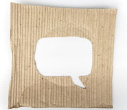 Old cardboard paper with speech bubble hole. In the middle Stock Photography