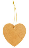 Old cardboard tag in the shape of a heart with golden thread Stock Photos