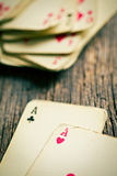 Old cards on wooden table Royalty Free Stock Photo