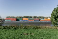 Old cargo containers behind the green field. In the German province stock photo