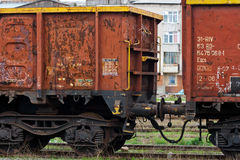 Old cargo railroad truck. These are romanian built railroad cars. Are really old and they are left to rust near a train station. These type of trucks are used to Stock Photo