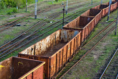 Old cargo railroad trucks. These are romanian built railroad cars. Are really old and they are left to rust near a train station. These type of trucks are used Royalty Free Stock Photography