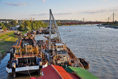 Old cargo ships with city river Stock Photo