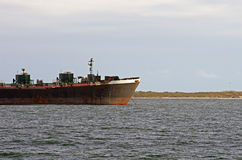 Old cargo vessel docked in the Gulf of Mexico Stock Image
