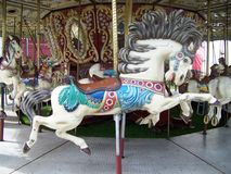 Old Carousel Horse. Beautiful old flying Carousel Horse in all it's colors Royalty Free Stock Photos