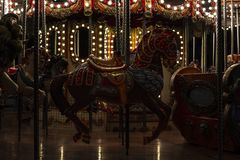 Old carousel with horses  and other figures royalty free stock photo