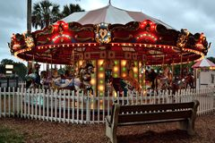 An Old Carousel in a Park. An old carousel lit up at dusk Royalty Free Stock Photography