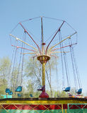 Old carousel with seats on chains Royalty Free Stock Photos