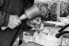 Old Carpenter carving a wooden carnival mask. Stock Images