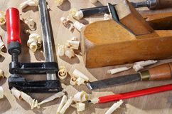 Old  carpenter plane tools and wood shavings Stock Photo