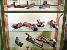 Old carpenter planes in vintage antique store Royalty Free Stock Image