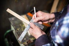 Old carpenter taking measurement Royalty Free Stock Images