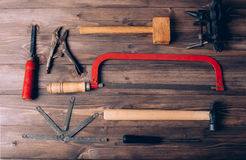 Old carpenter tools. On brown wooden background royalty free stock photo