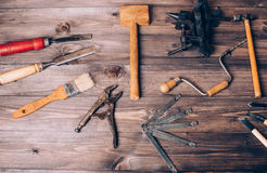 Old carpenter tools. On brown wooden background stock images