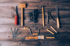 Old carpenter tools. On brown wooden background royalty free stock photography