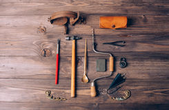 Old carpenter tools. On brown wooden background stock photo