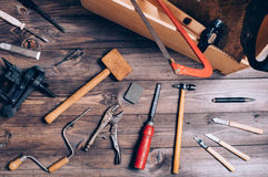 Old carpenter tools. On brown wooden background stock photos