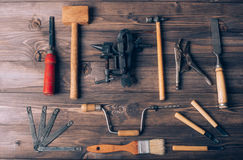 Old carpenter tools. On brown wooden background stock image