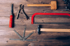 Old carpenter tools. On brown wooden background royalty free stock photos