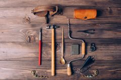 Old carpenter tools. On brown wooden background royalty free stock images