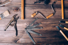 Old carpenter tools. On brown wooden background royalty free stock image
