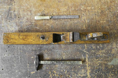 Old carpenter tools planer, hammer and rasp on vintage wooden ba Stock Photography