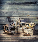 Old carpenter tools in a wooden box Royalty Free Stock Photos