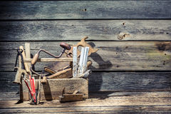 Old carpenter tools. On old wooden table Stock Image