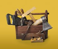 Old Carpenter Wooden toolbox with tools isolated on white stock photography
