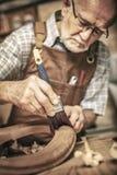 Old carpenter at work royalty free stock image