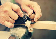 Old carpenter working with wood Stock Photos