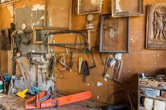 Free Old Carpentry Tools In Home Workshop. Repair Of Agricultural Machinery. Old Planers And Drills On Workshop Wall Stock Images - 178978284
