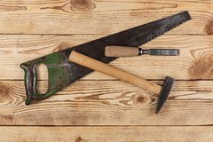 Old carpentry tools. On a wooden background royalty free stock photo