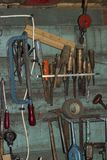 Old carpentry tools. On the wall stock images