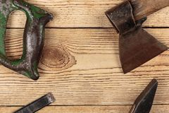 Old carpentry tools. On a wooden background royalty free stock images