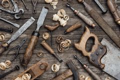 Old carpentry tools on the workbench. Old used woodworking tools on a vintage workbench: carpentry, craftsmanship and handwork concept stock photos