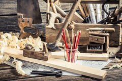 Old carpentry workbench and drawing workshop. On old wooden table Royalty Free Stock Photography